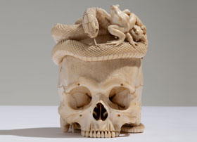 Japanese Ivory Skull with Coiled Snake and Toads